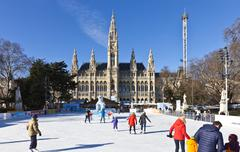 Ice skaters at Wiener Eistraum in font of the City Hall of Vienna Stock Photos