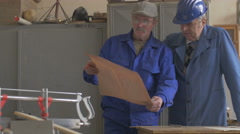 People and teamwork, team of two men at work in workshop Arkistovideo
