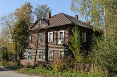 Old two-storey log house - stock photo