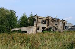 Stock Photo of Ruins of old wooden house in the village