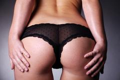 female butt with panties - stock photo