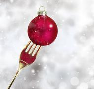 Golden fork with Christmas ball in a glittery background - stock illustration