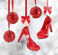 High heels shoes and Christmas balls hanging on red ribbon - stock illustration