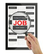Searching for a job with a magnifying glass in a digital tablet - stock illustration