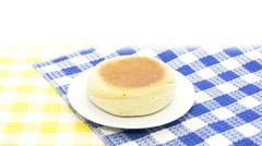 English muffin bread on contrast table mat - stock photo