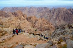 Tourists descend from the top of Mount Moses, Egypt - stock photo