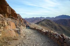 Tourists descend on the long trail to Mount Moses, Egypt - stock photo