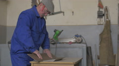 Carpenter working in a shop Stock Footage