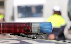 Red and blue siren police car during the roadblock - stock photo