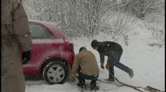 4K Italian put metal chain on a red car auto which in heavy winter storm Stock Footage