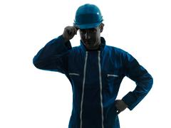 man construction worker saluting silhouette - stock photo