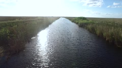 Aerial Running Down The River in the Everglades Stock Footage