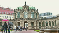 Tourists with umbrellas at Zwinger Dresden Stock Footage