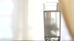 Stock Video Footage of Glass of water with Aspirin