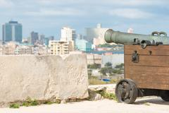 Old cannon aiming at the city of Havana Stock Photos