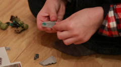 Boy playing with Legos Stock Footage