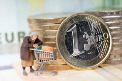 Stock Photo of Old woman and euro money