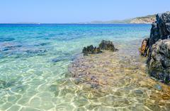 Clear water at the scenic wild beach, Sithonia, Greece Stock Photos