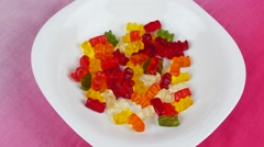 Gummy bears rotating on white Stock Footage