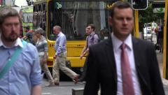 People cross the road, Lambton Quay shopping street, Wellington, New Zealand Stock Footage