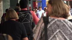 Crowd of people walk along shopping street, Wellington, New Zealand Stock Footage