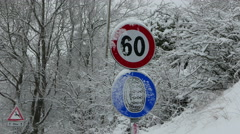 4K Italy snow scene Traffic sign of 50 kmh Stock Footage