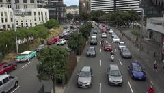 Busy commuter traffic moves along main road, Wellington, New Zealand Stock Footage