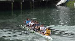 Rowing boat, Wellington waterfront skyline, New Zealand Stock Footage