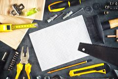 Assorted Do It Yourself Tools and Notebook Stock Photos