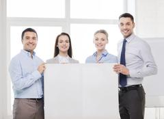 Business team in office with white blank board Kuvituskuvat