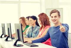 Male student with classmates in computer class Stock Photos