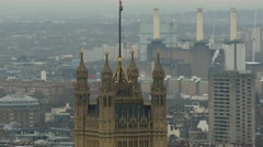 One of tallest buildings in London with a flag on top - stock footage
