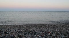 Pebble beach surf at sunset Stock Footage