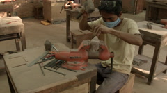 Man carving soapstone buddha in Cambodia Stock Footage
