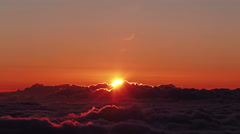 Beautiful sunrise over clouds, time lapse Stock Footage