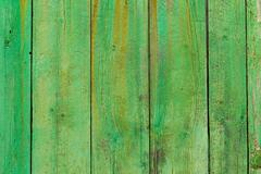 Stock Photo of Alcudia Old Town aged green door wood texture