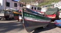 4k Camara de Lobos fishing village harbor boats panning Footage