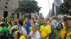 Brazilian singing the national anthem in Avenida Paulista, Sao Paulo - stock footage