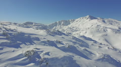 Stock Video Footage of AERIAL: Snowy mountains in winter