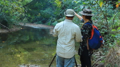 Wildlife Photographer working together Stock Footage
