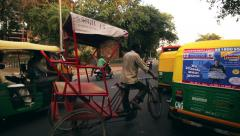 Stock Video Footage of Rickshaws, motorbikes, cars and buses stop at a traffic jam in Delhi