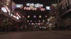 A wide shot of Pub Street (including signage) in Siem Reap Cambodia at night Stock Footage