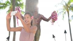 Waikiki Beach Tourist in Honolulu on Oahu Hawaii taking selfie photograph Stock Footage