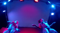 Sexy dancers on the stage of summer nightclub (static, from bottom) Stock Footage