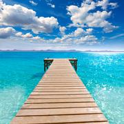 Platja de Alcudia beach pier in Mallorca Majorca - stock photo