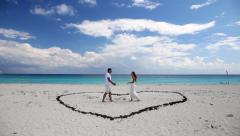 Young beautiful newlyweds meet each other on beach Stock Footage