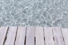 Platja de Alcudia beach pier in Mallorca Majorca - stock photo
