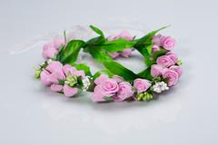 Tiara of artificial  roses on a light background Stock Photos
