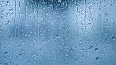 Raindrops on the window. Blue tone Stock Footage