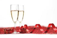 Champagne on glitters Stock Photos